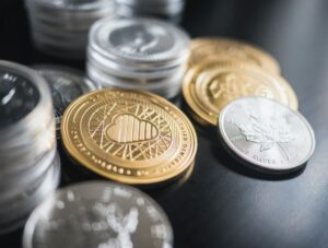 gold and silver coins on a table